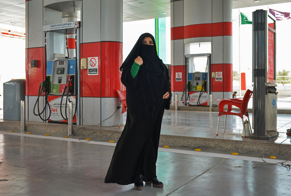 Murfa Bukhalid, a Saudi petrol station supervisor, poses for picture at the petrol station where she works in Khobar, some 400 kilometres east of Riyadh, on February 20, 2018. / AFP