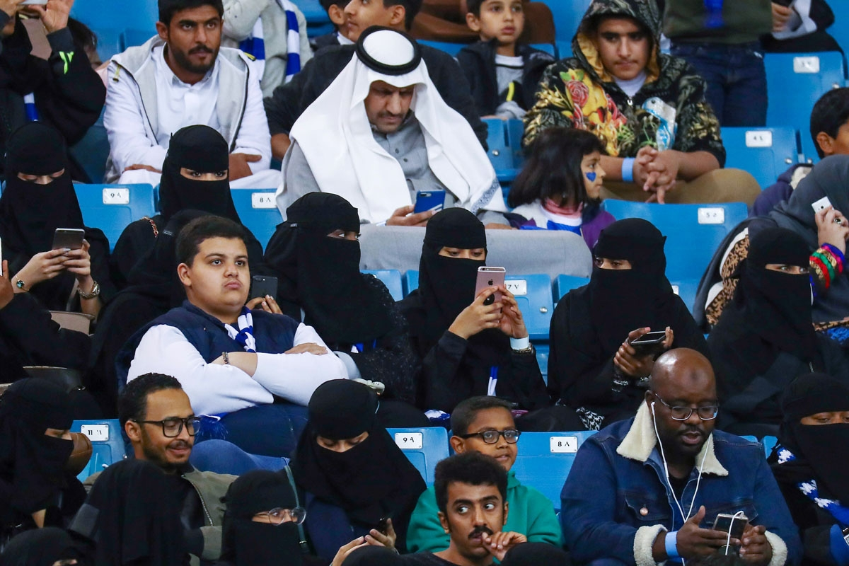 Female supporters of Saudi's Al-Hilal attend their team's football match against Al-Ittihad in the Saudi Pro League at the King Fahd International Stadium in Riyadh on January 13, 2018.