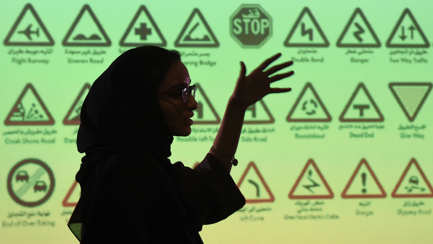 "An employee of Careem, a chauffeur driven car booking service, talks during a training session for new female drivers, known in the company as ""captains"" at their Saudi offices in Khobar City, some 424 kilometres east of the Saudi capital of Riyadh, on Oc"