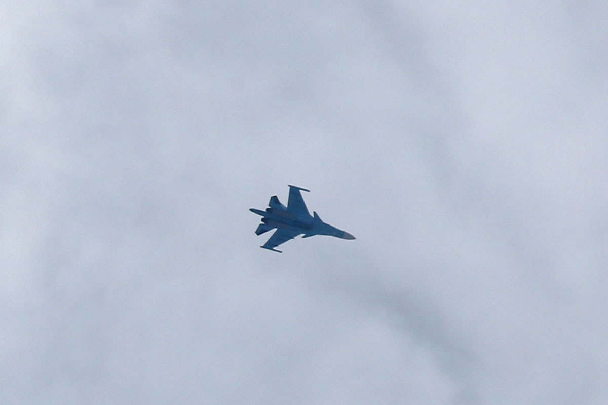 A picture taken on February 20, 2018 shows a Russian air force Sukhoi Su-34 fighter jet flying over the sky in the rebel-held town of Arbin, in the besieged Eastern Ghouta region on the outskirts of the capital Damascus.