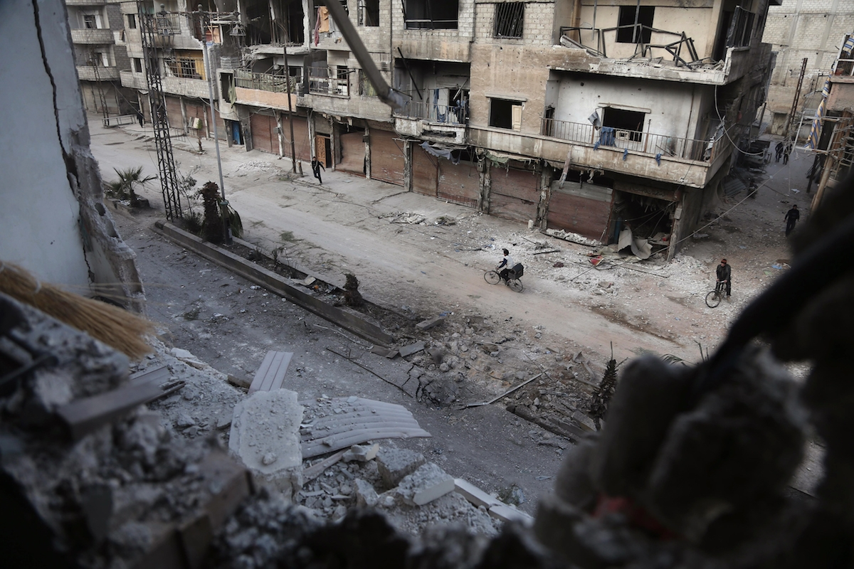 A picture shows the scene following a reported regime air strike in the rebel-held town of Hamouria, in the besieged Eastern Ghouta region on the outskirts of the capital Damascus on February 21, 2018.
