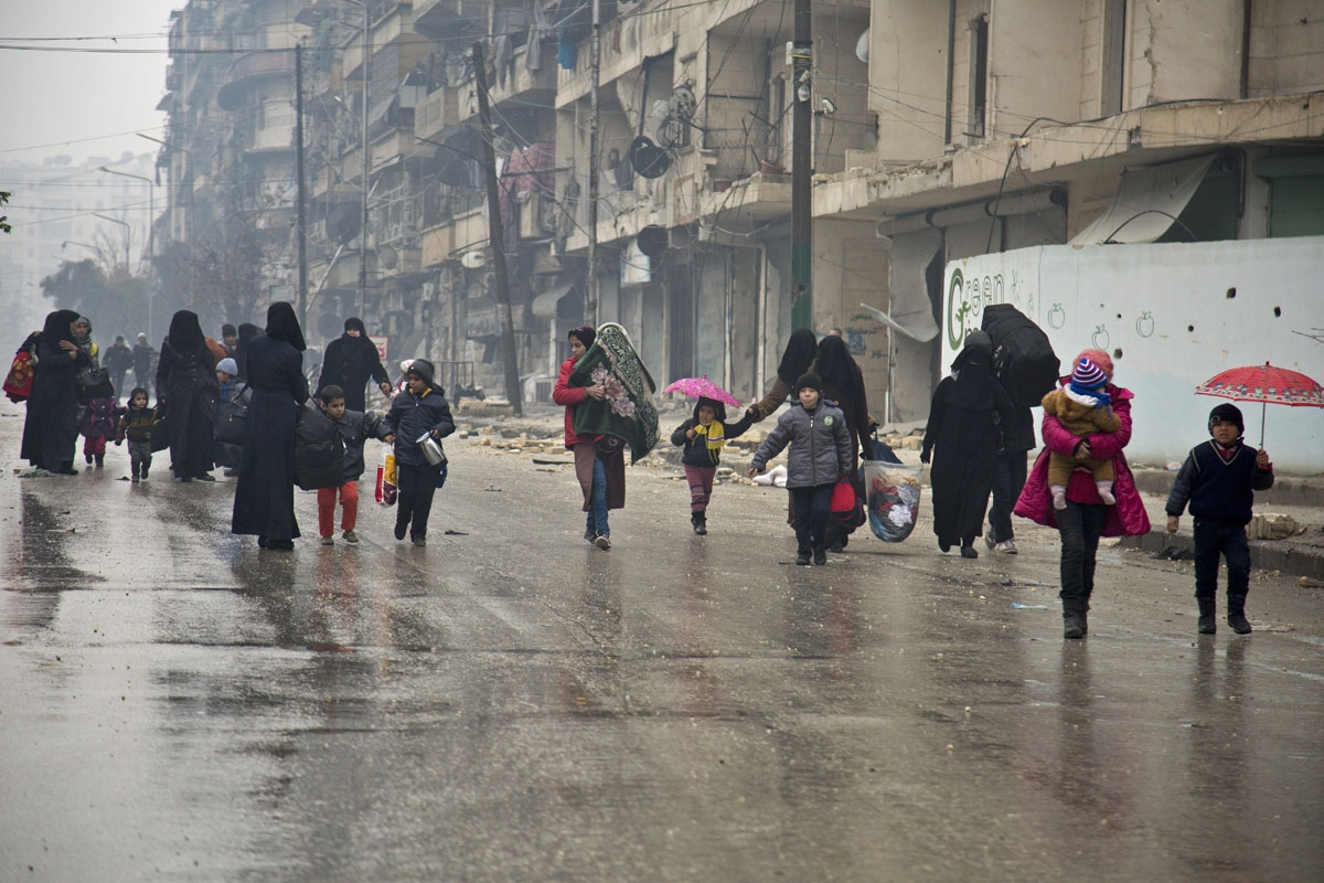 Syrians leave a rebel-held area of Aleppo towards the government-held side on December 13, 2016 during an operation by Syrian government forces to retake the embattled city. UN chief Ban Ki-moon expressed alarm over reports of atrocities against civilians