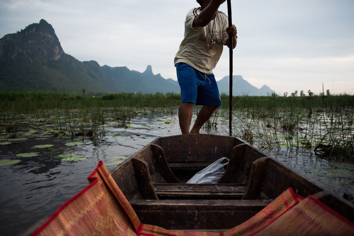 In this photograph taken on May 5, 2017, a local canoe owner makes his way through a lake in the Khao Sam Roi Yot national park in southern Thailand.