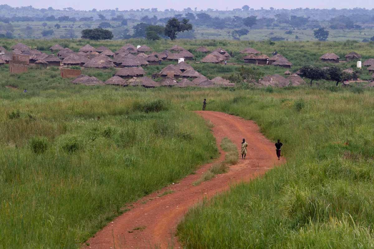 Children walk on a road leading to the northern Ugandan village of Amuru on August 26, 2010.