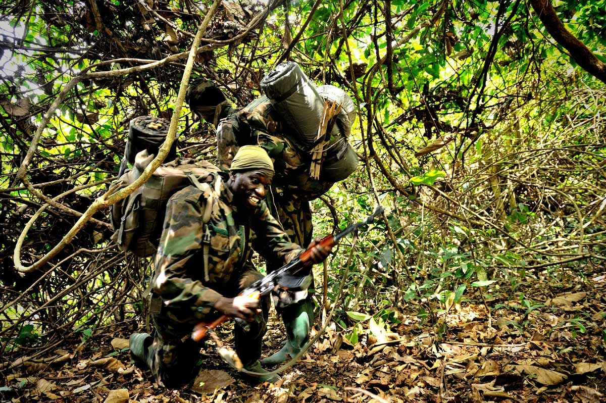 Ugandan soldiers patrol on April 19, 2012 through the central African jungle during an operation to fish out notorious Lord's Resistance Army (LRA) leader Joseph Kony.