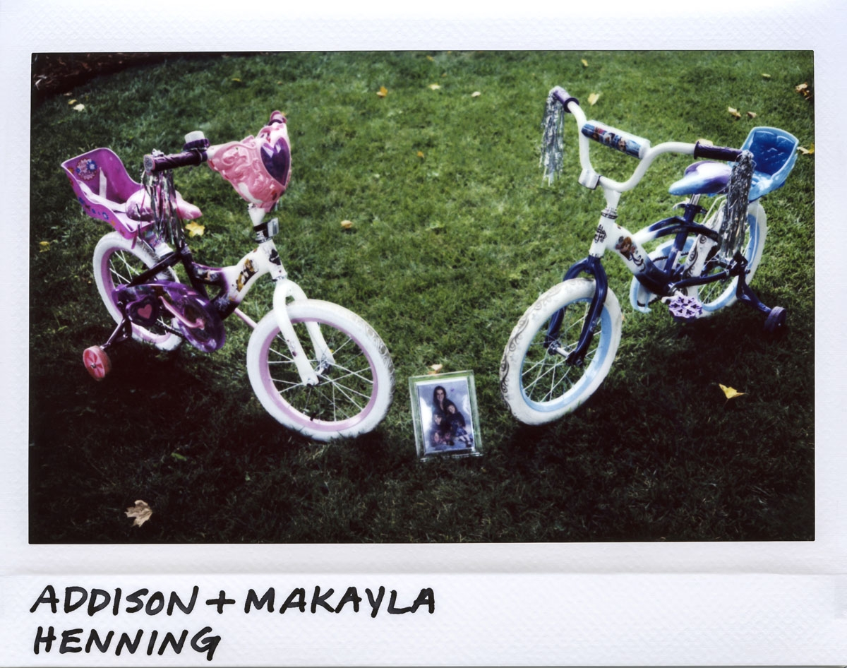 The bicycles of 5-year-old twins Addison and Makayla Henning are seen on their front lawn in the 400 block of North Reed Street in suburban Joliet, Illinois on August 31, 2017.  The girls died from multiple gun shots to the head and their mother Celisa He