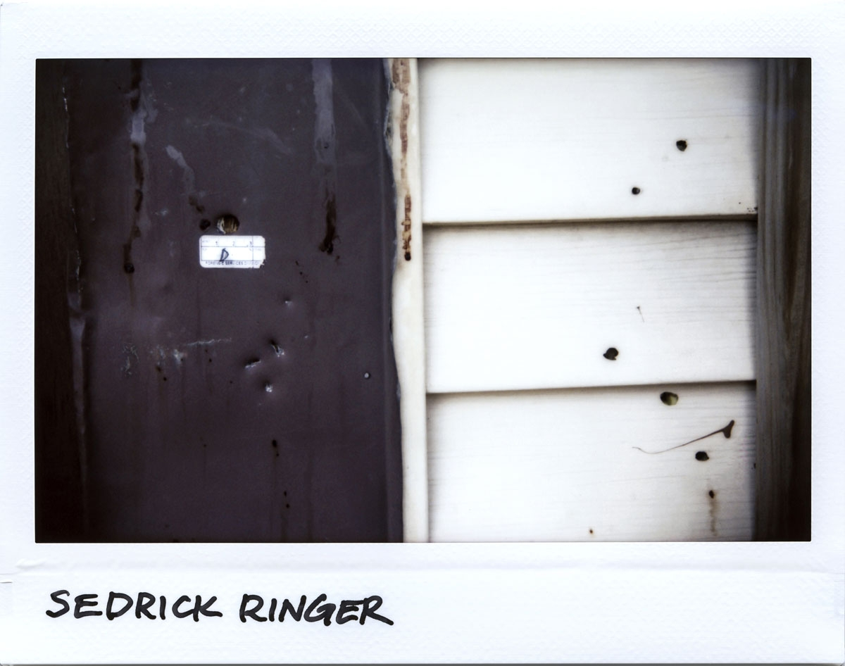Bullet holes are seen around the front porch where Sedrick Ringer, 50-year-old, was killed in the 5700 block of South Wells Street in Chicago, Illinois on July 3, 2017.  Ringer was shot 9 times and died at the scene June 30, 2017.
