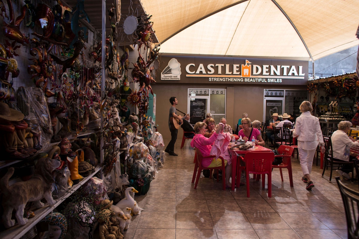 Visitors from the United States sit near a souvenir stand and dental clinic in downtown Los Algodones, near the US/Mexico border on February 15, 2017, northwestern Mexico.