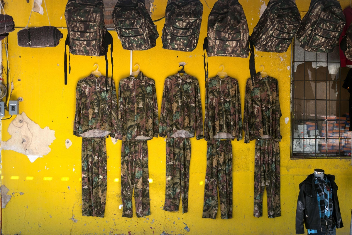 Backpacks and clothing  with camouflage are displayed for sale among other goods for migrants crossing the desert, at a local shop in Altar some 117 kilometres south the US/Mexico border, on February 16, 2017, northwestern Mexico.