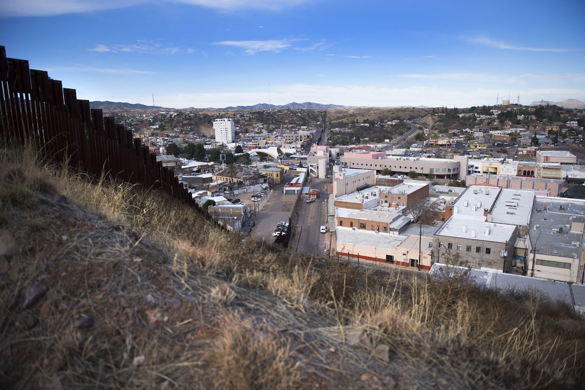 The border fence stretching through Nogales, Arizona, and Nogales, Mexico, is seen on February 17, 2017, on the US/Mexico border.