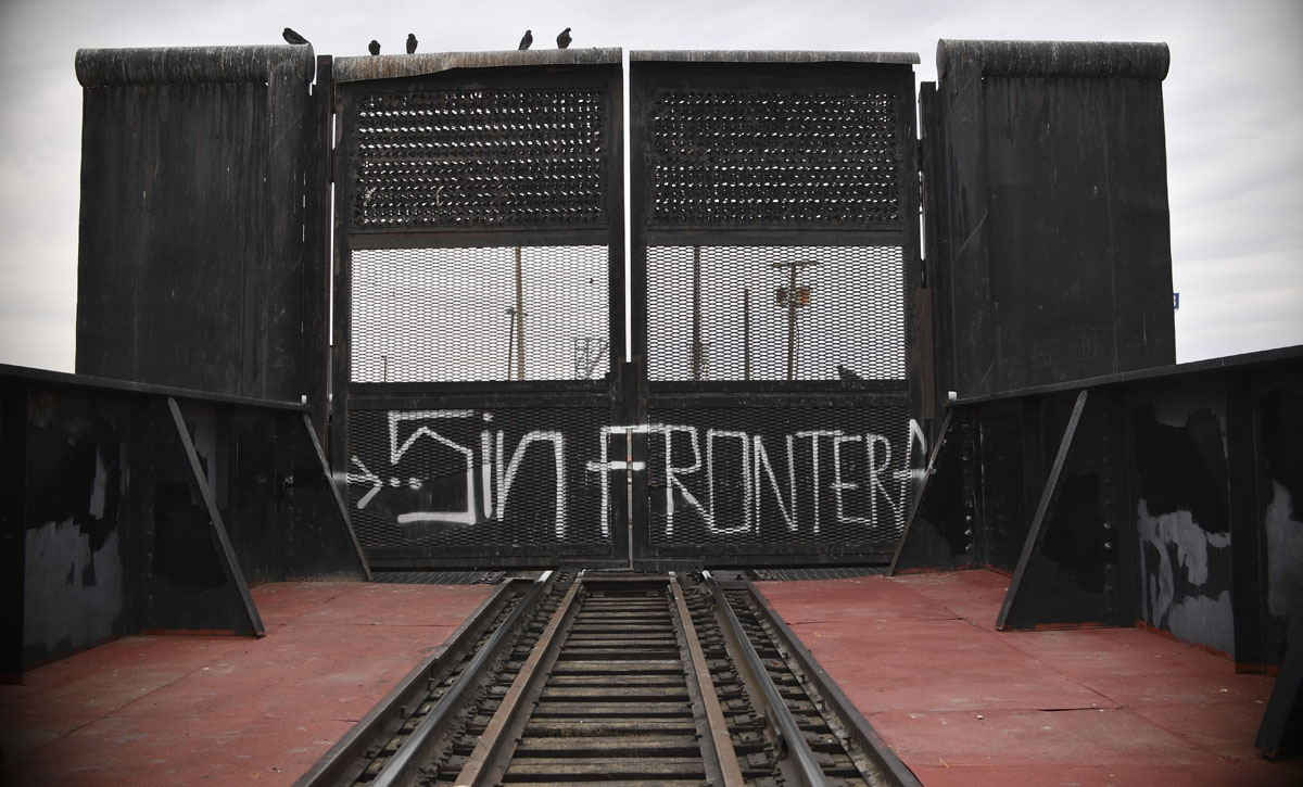 Train rails from the Mexiccan border of Ciudad Juarez to US city of El Paso Texas closed panel and sign reading ''Sin Frontera'' is seen on February 18, 2017.