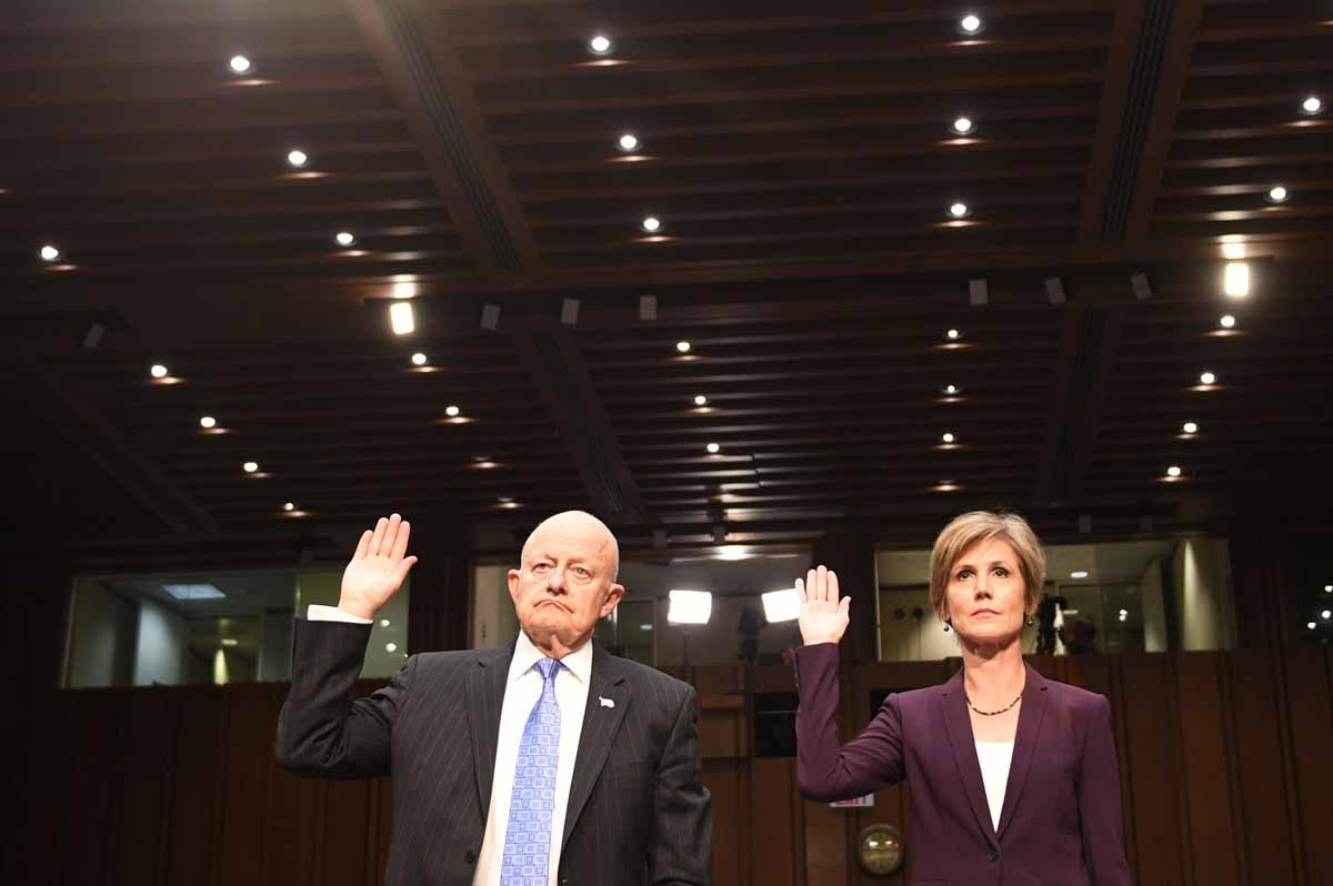 Former acting Attorney General Sally Yates (R) and former Director of National Intelligence James Clapper (L) are sworn in prior to testifying on May 8, 2017, before the US Senate Judiciary Committee on Capitol Hill in Washington, DC. /