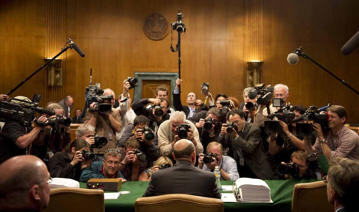 Try getting an original photo from there. Photographers jostle for position in a tiny space as Goldman Sachs CEO Lloyd Blankfein (C) arrives to testify before a Senate investigative committee on Capitol Hill in Washington, DC, April 27, 2010.