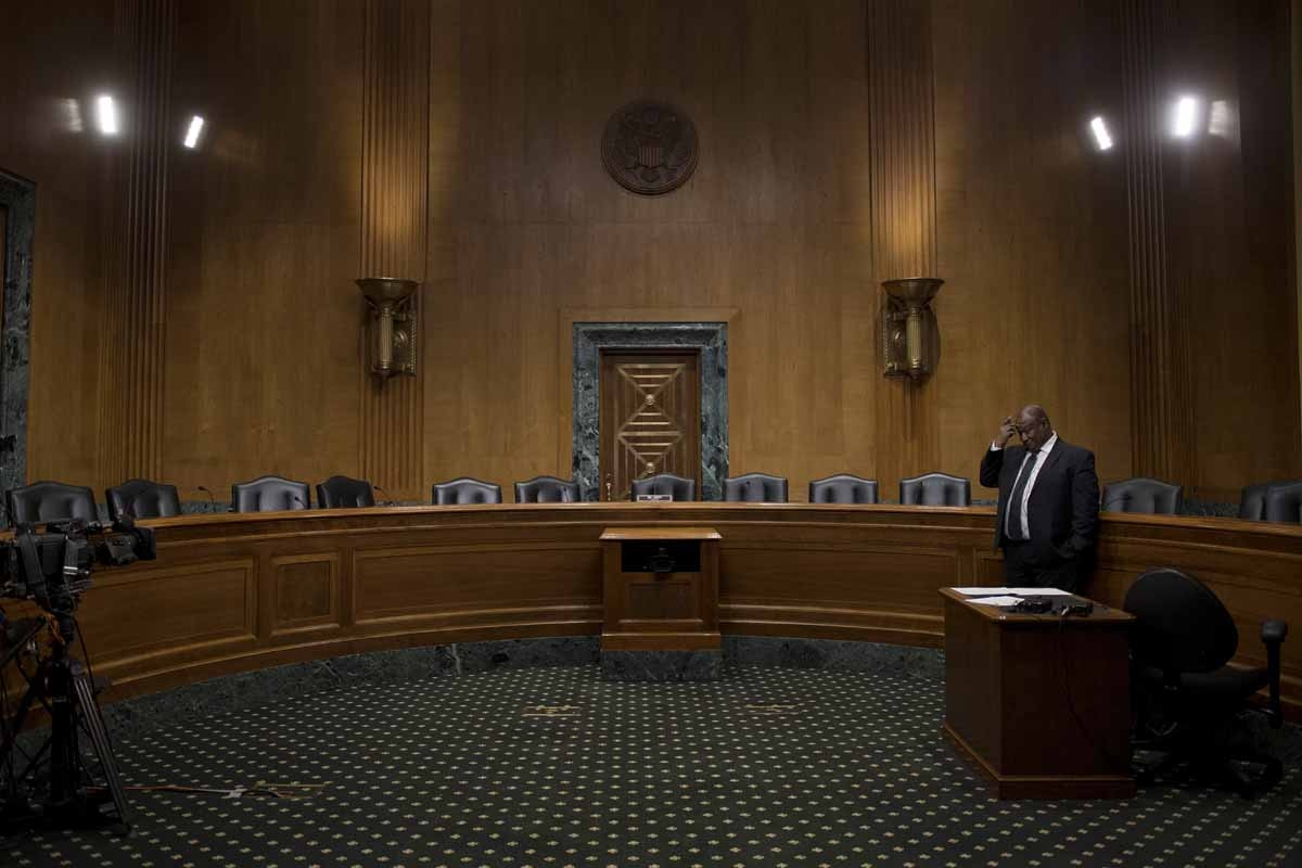 Empty seats in the Senate Finance Committee hearing room on Capitol Hill in Washington, DC, January 31, 2017, after Senate democrats boycotted the markup hearings for the nominations of Steven T. Mnuchin, of California, to be Secretary of the Treasury,