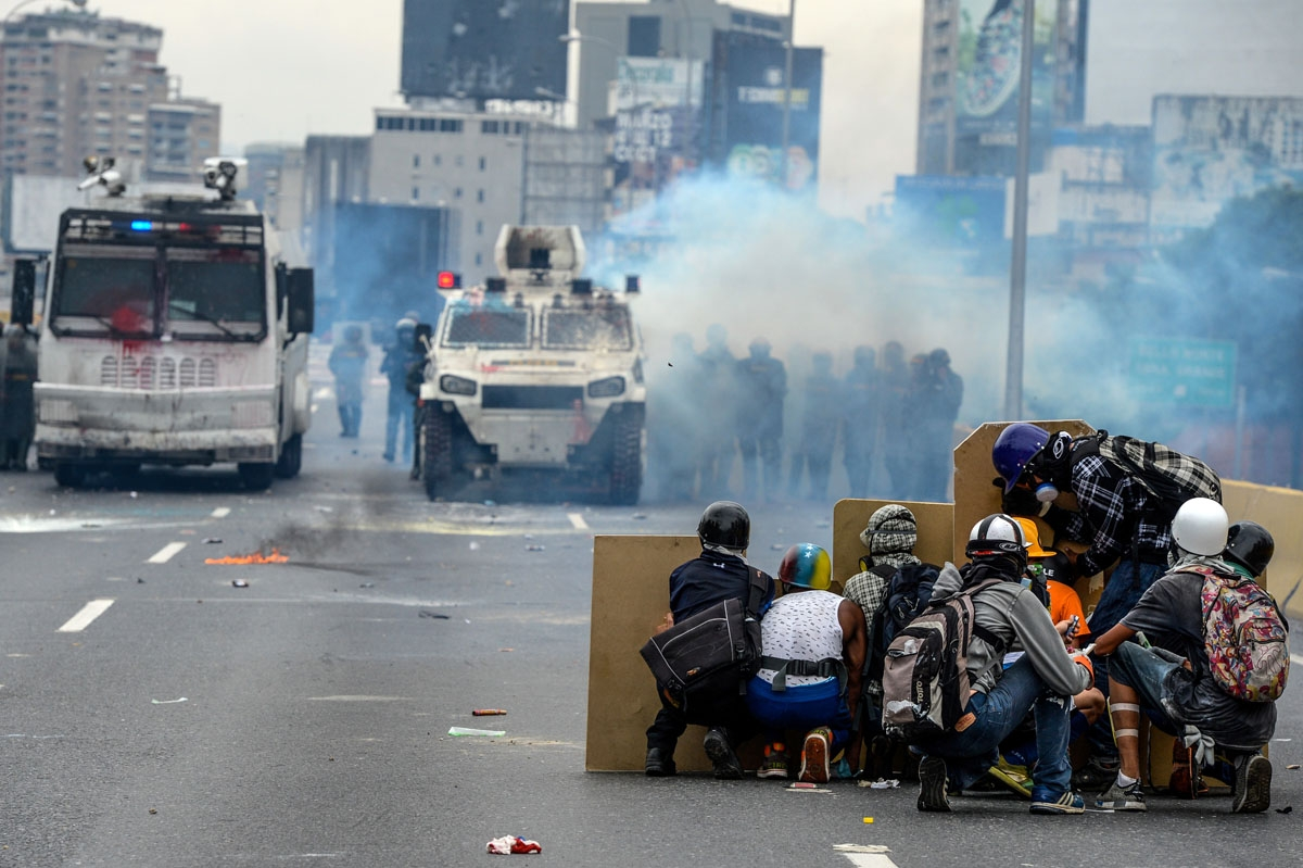 Opposition activists and riot police clash during a protest against President Nicolas Maduro, in Caracas on May 8, 2017.