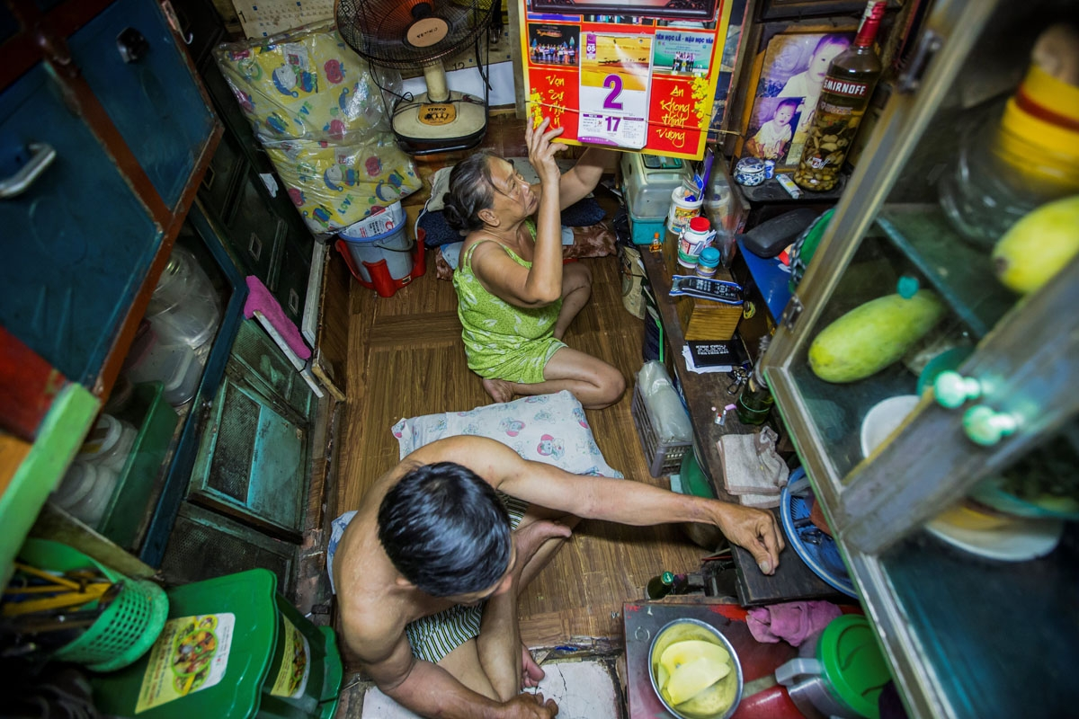 Kha Tu Ngoc and her husband Pham Huy Duc prepare for dinner in their two-square-meter house in Ho Chi Minh City on May 2, 2018.