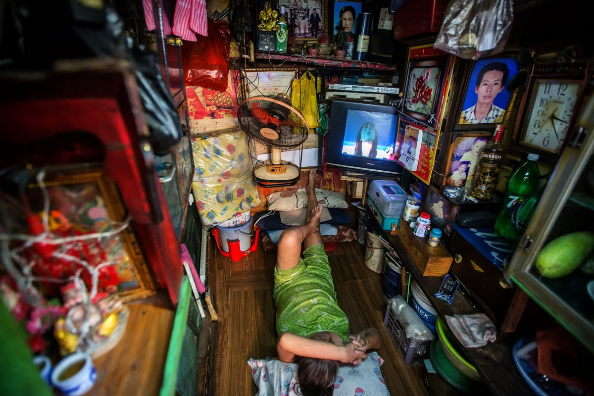 Kha Tu Ngoc rests in her two-square-meter house in Ho Chi Minh City on May 2, 2018.