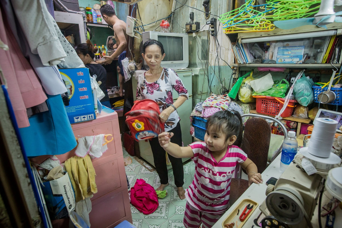 Nguyen Thi Kim Ngoc and her husband Nguyen Van Truong are seen with their granddaughter in their 6.7-square-metre home in Ho Chi Minh City on May 3, 2018.