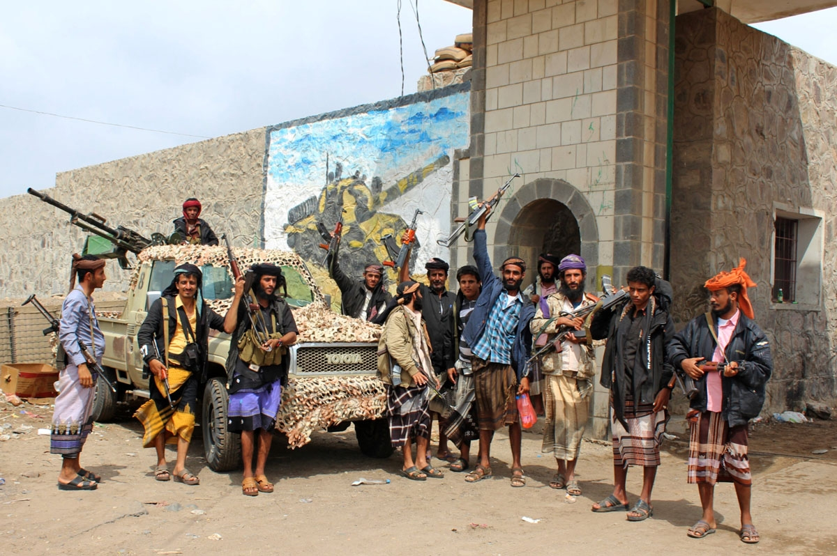 Fighters from the separatist Southern Transitional Council stand at the entrance of a military camp after they took control of the pro-government position in the Dar Saad district, in the north of Aden, on January 31, 2018