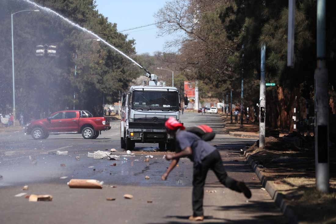 Zimbabwe opposition supporters clash with police during a protest march for electoral reforms on August 26, 2016 in Harare.
