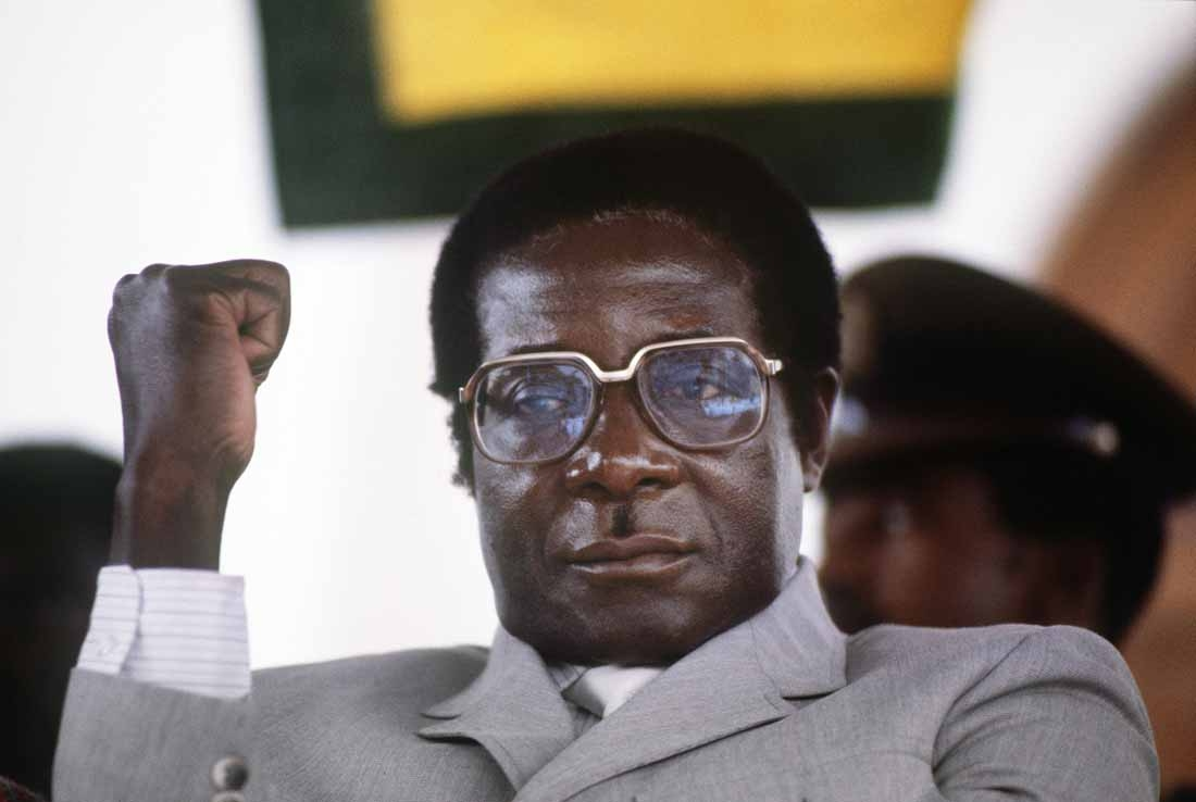 Robert Mugabe, then prime minister, gestures at a Harare stadium during a meeting on July 1, 1984.