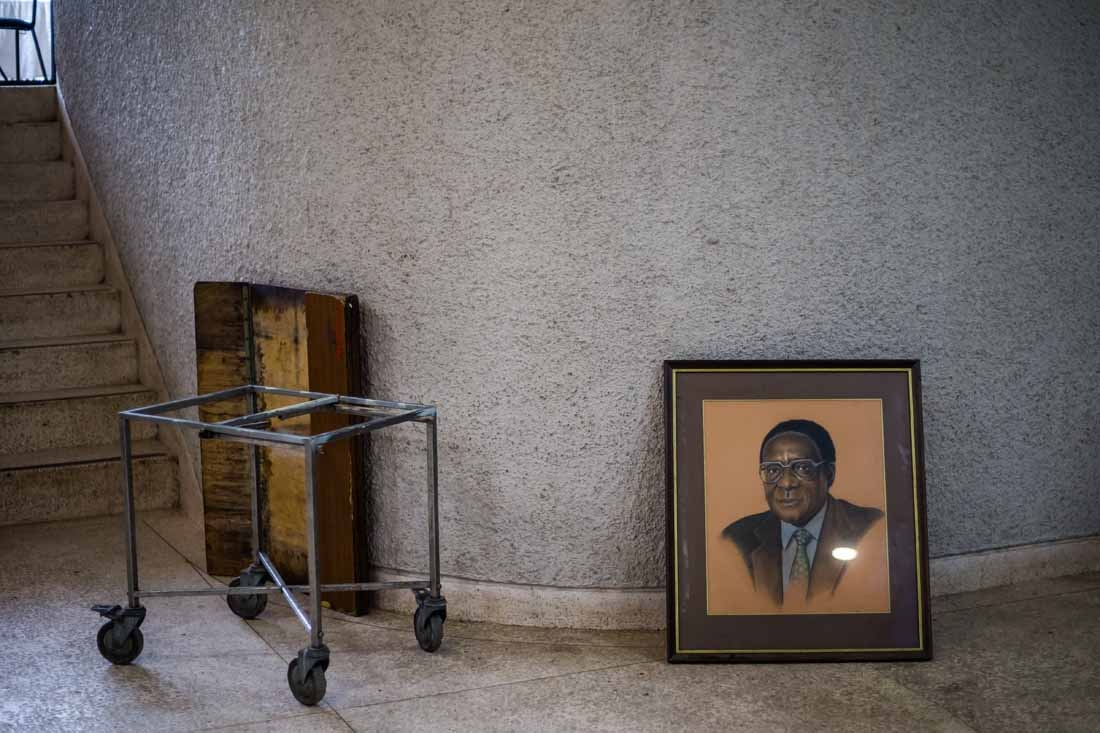 A picture taken on December 14, 2017 shows a portrait of former Zimbabwe President Robert Mugabe after it was removed from the hall during the 107th annual conference of the Zanu-PF Central Committee at the party headquarters in Harare on December 14, 201