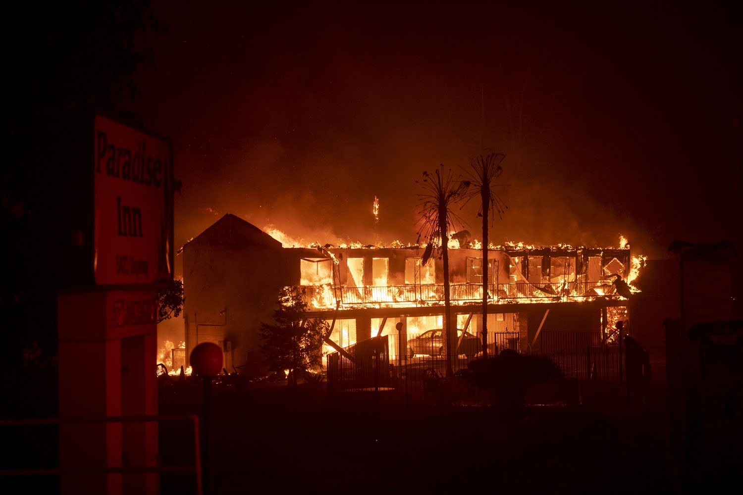 The Paradise Inn hotel burns as the Camp Fire tears through Paradise, North of Sacramento, California on November 08, 2018. - More than one hundred homes, a hospital, a Safeway store and scores of other structures have burned in the area and the fire show