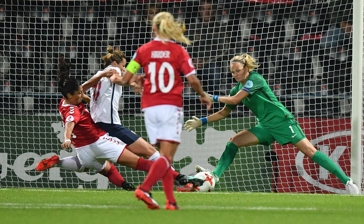 Norway's goalkeeper Ingrid Hjelmseth (R) vies with Denmark's Nadia Nadim (L) during the UEFA Women's Euro 2017 football tournament match between Norway and Denmark at Stadion De Adelaarshorst in Deventer city on July 24, 2017.