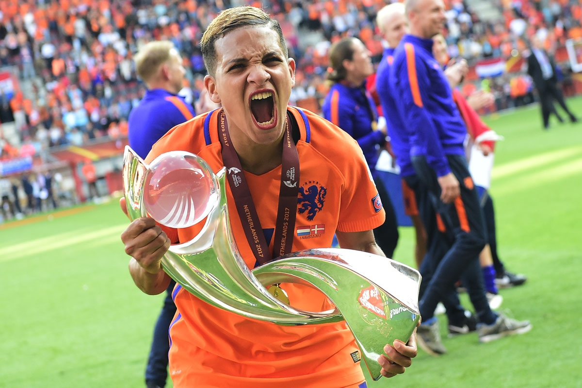 Netherlands' forward Shanice van de Sanden celebrates with the trophy after winning with her team the UEFA Women's Euro 2017 football tournament final match between Netherlands and Denmark at Fc Twente Stadium in Enschede on August 6, 2017