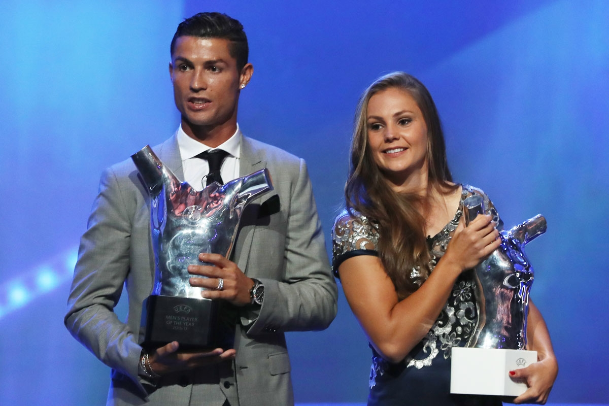 Real Madrid's Portuguese forward Cristiano Ronaldo (L) and Netherlands' midfielder Lieke Martens pose after he was awarded the title of UEFA 2016/17 Best football Player and she was awarded UEFA 2016/17 Best Women's football Player at the conclusion of th