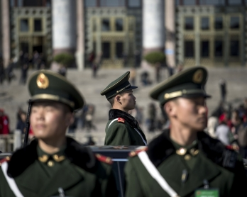Paramilitary police officers stand in front of the Great Hall of the People during the opening of the National People's Congress in Beijing on March 5, 2017.  China's rubber-stamp congress opened on March 5 in an annual pageant of Communist-controlled dem