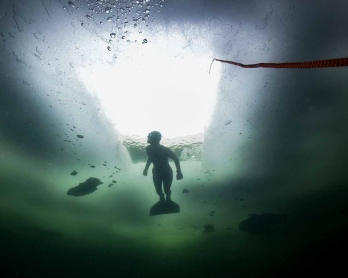Johanna Nordblad, 42, Finnish freediver swims under ice during a Ice-freediving training session on February 28, 2017, in a green lake in Somero (southwest Finland).