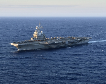 An aerial view shows French aircraft carrier Charles de Gaulle sailing past in the Mediterranean sea on September 27, 2016 on its way to the Western Mediterranean as part of the Operation Arromanches III