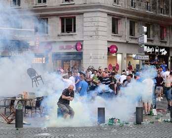 Tear gas is released by French police as England fans gather in Marseille, southern France, on June 10, 2016, ahead of England's Euro 2016 football match against Russia