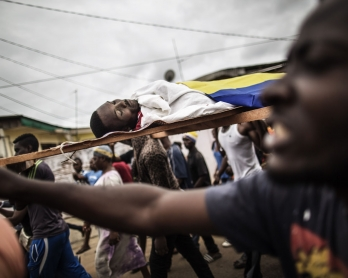 Dozens of protesters carry in a funeral procession the body of Axel Messa, 30, wrapped in the flag of Gabon, in a street of the Libreville district of Nzeng Ayong on September 2, 2016