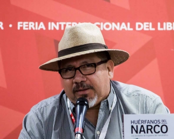 This file photo taken on November 27, 2016 shows Mexican journalist Javier Valdez speaking during the presentation of his book Huerfanos del Narco  in the framework of the International Book Fair in Guadalajara, Mexico.