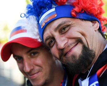 Russian fans pose for picture during the opening ceremony of the FIFA Fan Fest in Nizhny Novgorod on June 14, 2018, during the Russia 2018 World Cup
