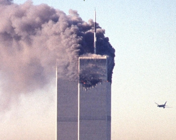 A hijacked commercial plane approaches the World Trade Center shortly before crashing into the landmark skyscraper 11 September 2001 in New York