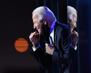 US President-elect Joe Biden gestures to the crowd after he delivered remarks in Wilmington, Delaware, on November 7, 2020. - Democrat Joe Biden was declared winner of the US presidency November 7, defeating Donald Trump and ending an era that convulsed A