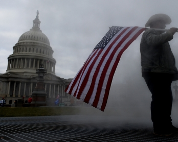Supporters of US President Donald Trump hold a rally outside the US Capitol as they protest the upcoming electoral college certification of Joe Biden as President in Washington, DC on January 6, 2021. - Joe Biden's Democratic Party took a giant step Wedne