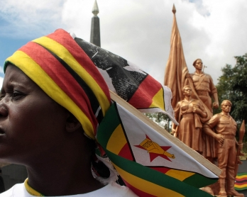 A supporter of Zimbabwean President Robert Mugabe's ruling ZANU-PF attends the funeral of Harare Governor David Karimanzira at the National Heroes Acre in Harare on March 27, 2011. Police on March 27 barred Zimbabwean Prime Minister Morgan Tsvangirai's pa