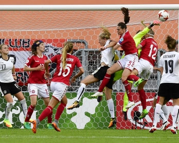 Austria's goalkeeper Manuela Zinsberger (3R) and Denmark's forward Stine Larsen jump for the ball during the UEFA Women's Euro 2017 football tournament semi-final match between Denmark and Austria at the Rat Verlegh Stadium, in Breda, on August 3, 2017