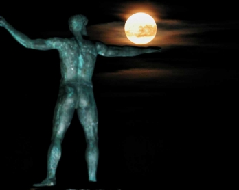 The 'Supermoon' rises above the statue of the ancient Greek god Poseidon in Ancient Corinth on November 14, 2016.